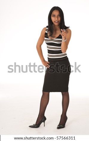 Young adult African-Indian businesswoman in casual office outfit with a black pencil skirt, a striped brown top and high heels on a white background. Not Isolated - stock photo