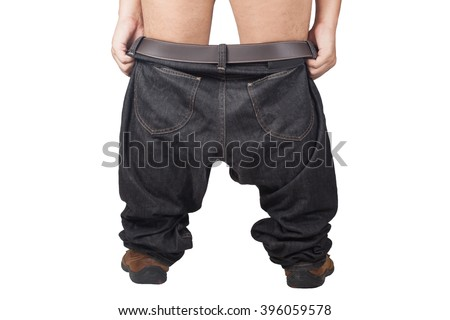 Young adult asian man pulls up or taking off his dark jeans, rear view, close-up studio. Isolate on white background - stock photo