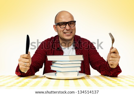 Young adult bold man served with few books on a dinner plate