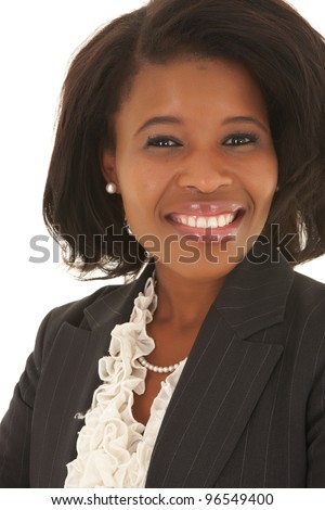 Young adult Caucasian businesswoman wearing a grey suit with curly brown hair on a white background. NOT ISOLATED