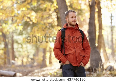 Young adult Caucasian man walking in a forest, close up - stock photo