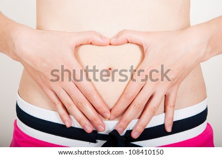 Young adult checking her belly fat - stock photo