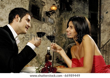 young adult couple having dinner outdoor - stock photo
