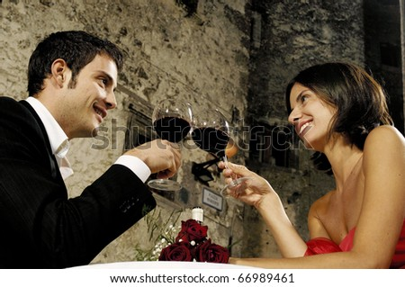 young adult couple having dinner outdoor