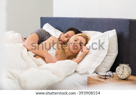 Young adult couple sleeping peacefully on the bed in bedroom  Young man  embracing woman while. Couple Sleeping Stock Images  Royalty Free Images   Vectors