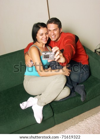 Young adult couple taking a picture together.