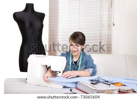 young adult fashion designer at work - stock photo