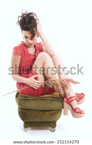 Young adult fashion girl sitting with flowers - stock photo
