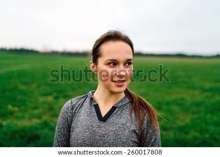 Young Adult Female in grass field - stock photo