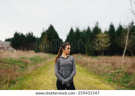 Young Adult Female standing in country