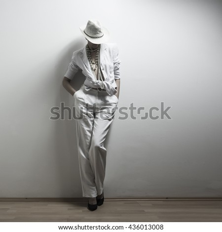 Young adult girl posing at fashion shot in white dress - stock photo