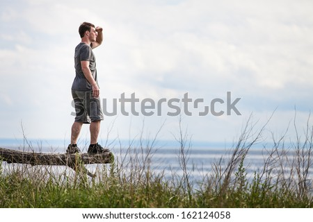 Young Adult in Nature Looking at The View. - stock photo