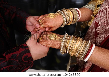Young adult male groom and female bride holding hands. - stock photo