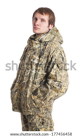 Young adult male hunter on white background - stock photo