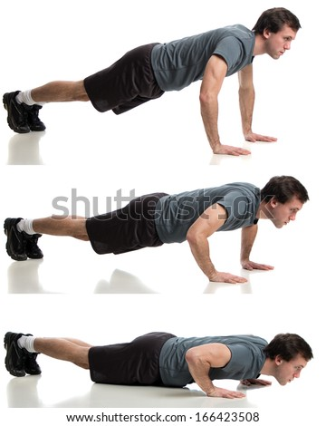 Young adult man doing push ups. Studio shot over white. - stock photo