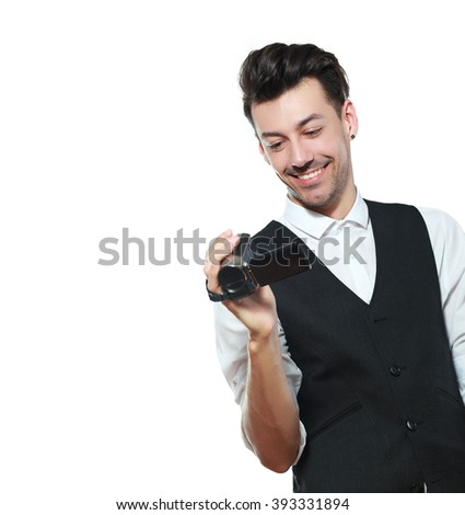 Young adult man holding an HD camcorder isolated on white background - stock photo