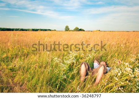young adult man in spring grass