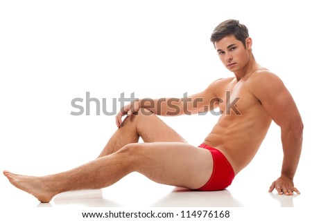 Young adult man in underwear. Studio shot over white. - stock photo