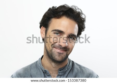 Young adult man looking at camera smiling with copy space