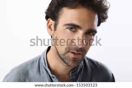 Young adult man with an intense gaze