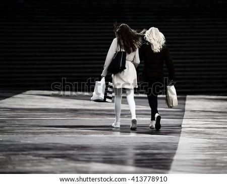 Young adult shopping women on city square - stock photo