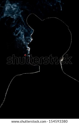 Young Adult Silhouette Smoking a cigarette in Silhouette