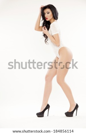 Young adult slim sexy and attractive sensuality brunette woman in white lingerie isolated on white background