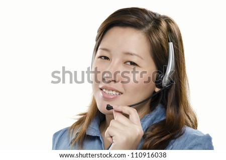 Young adult smiling with headset on - stock photo