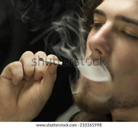 Young adult smoking cannabis