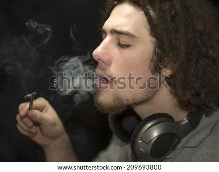 Young adult smoking marijuana - stock photo
