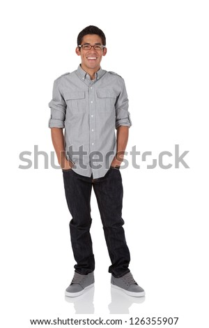Young adult standing with hands in pocket isolated on white