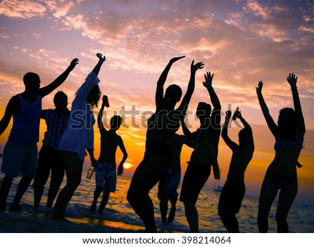 Young Adult Summer Beach Party Dancing Concept - stock photo