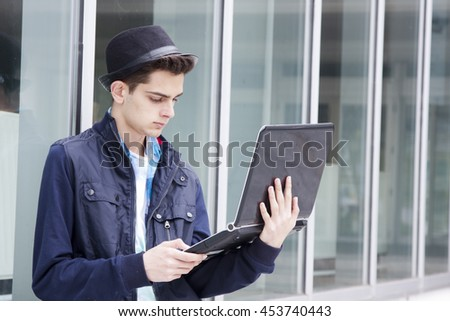 young adult with personal computer