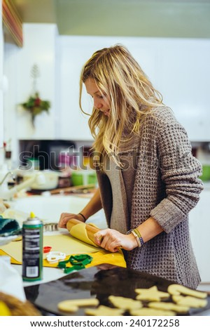 Young Adult Woman Baking in the Kitchen with a roller variation - stock photo