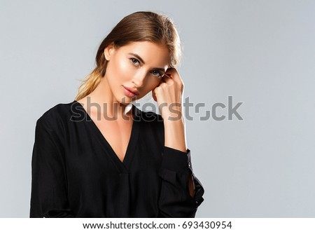 Young adult woman in black clothes dress portrait.