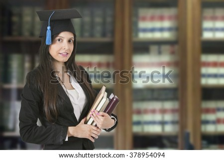 Young adult woman in the office licensed - stock photo
