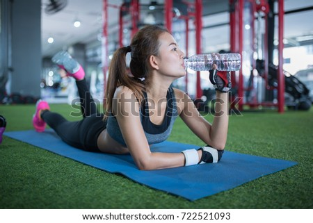 Young adult woman working out gym stock photo 722521093 shutterstock young adult woman working out in gym drink water sciox Gallery
