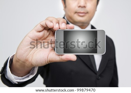 Young adult working on a digital phone - stock photo