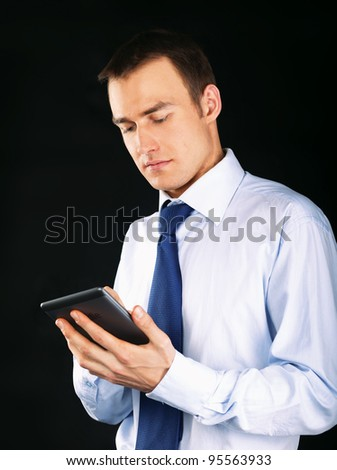 Young adult working on a digital tablet, isolated on white background - stock photo
