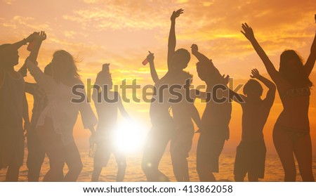 Young adults enjoying a tropical beach party. - stock photo