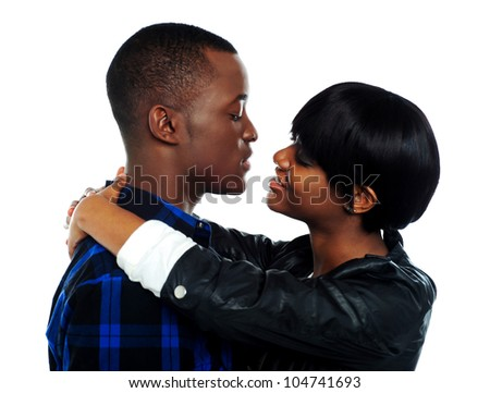 Young affectionate african couple hugging. Isolated over white background
