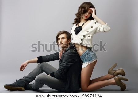 Young Affectionate Amorous Couple in Studio. Fondness - stock photo