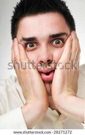 young afraid business man close up shoot - stock photo