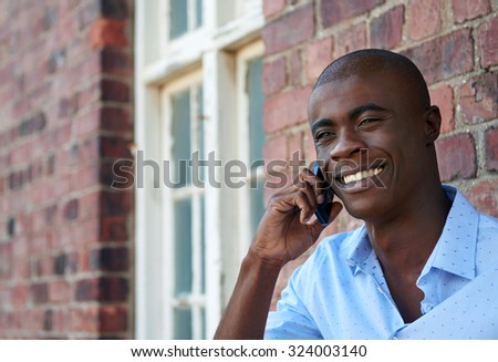 young african american black businessman talking on mobile cell phone outdoors - stock photo