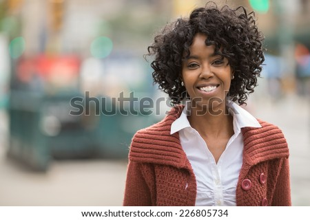 Young African American black woman in New York City smile happy face portrait