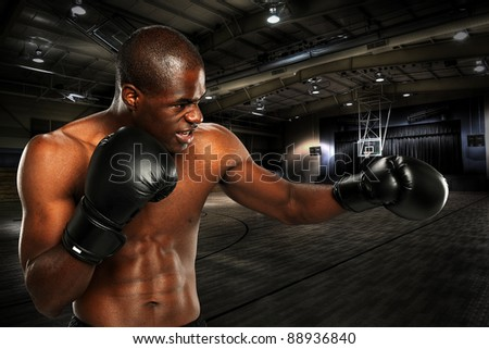 Young African American Boxer working out at a gym - stock photo