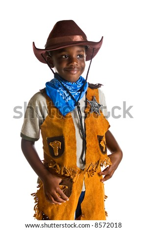 Young African American boy dressed as a cowboy. Isolated on a white background. - stock photo