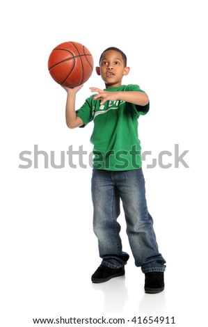 Young African American boy playing basketball isolated over white background - stock photo