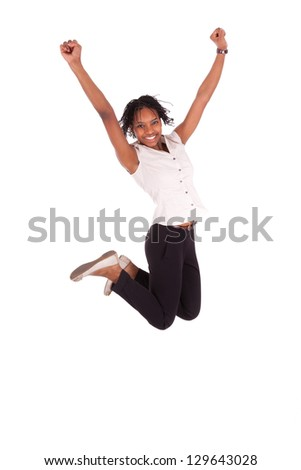 Young african american business woman jumping, success concept, isolated on white background - stock photo