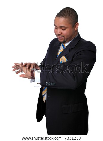 Young African-American businessman checking time on his watch.